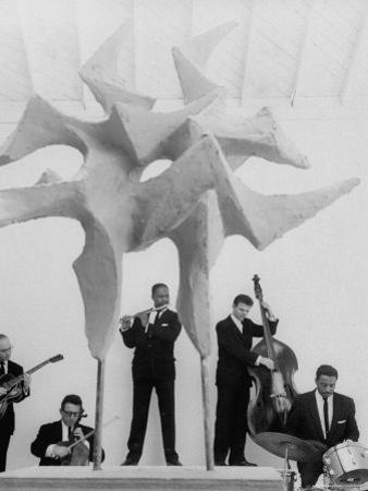 "Jazz Drummer Chico Hamilton Playing with Band Behind Sculpture Called ""Counterpoints"""
