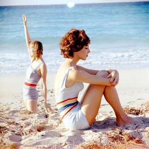 June 1956: Girls in Striped Swimsuit Modeling Beach Fashions in Cuba by Gordon Parks