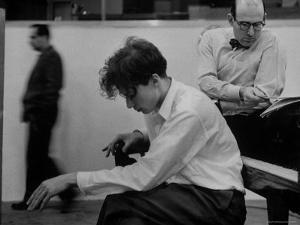 Pianist Glenn Gould Listening Intensely to Performance of Bach's Goldberg Variations Played Back by Gordon Parks