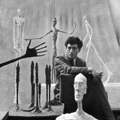 Portrait of Alberto Giacometti Surrounded by His Sculptures