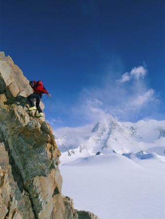 A Man Clings to the Side of 2850 Meter Mount Bearskin by Gordon Wiltsie