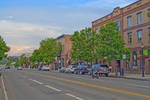 A Motorcyclist Drives Down Main Street in Bozeman, Montana by Gordon Wiltsie