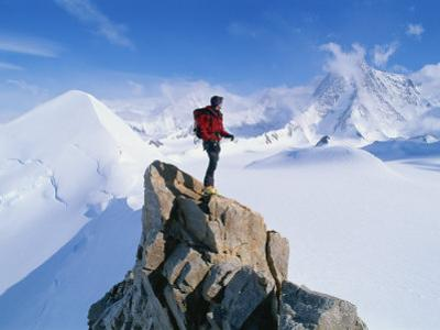 A Mountain Climber Summits Mount Bearskin by Gordon Wiltsie