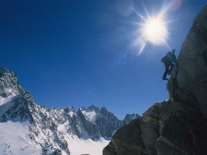 A Moutaineer Climbs Above Palisade Glacier in the Sierra Mountains by Gordon Wiltsie
