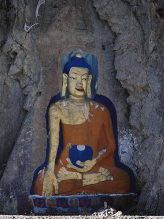 A Painted Stone Buddha Near Lhasa, Tibet by Gordon Wiltsie