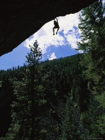 A Rock Climber Dangles from an Overhang in Kootenai Canyon by Gordon Wiltsie