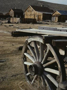 A View of Buildings and an Old Wagon at Bodie Ghost Town by Gordon Wiltsie