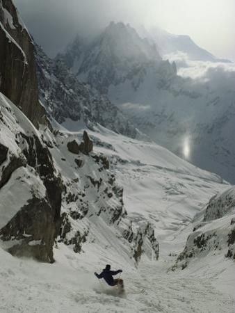 An Extreme Skier in Pas De Chevres Couloir Mount Blanc is in the Background by Gordon Wiltsie