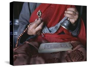 Buddhist Lama with Prayer Book, Prayer Beads and Dorge by Gordon Wiltsie