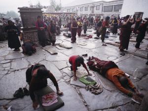 Buddhist Pilgrims Outside Jokhang Temple in Lhasa, Tibet by Gordon Wiltsie