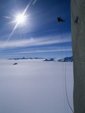 Conrad Anker uses ascenders to work his way up the sheer face of Rakekniven by Gordon Wiltsie