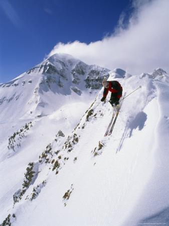 Downhill Skier Launching Off a Cornice in Front of Lone Mountain by Gordon Wiltsie