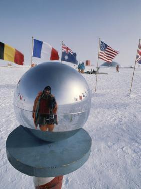 Flags of Many Nations and a Ceremonial Globe at the South Pole by Gordon Wiltsie