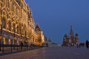Lighted Stores and Saint Basil's Cathedral Rise Beside Red Square by Gordon Wiltsie
