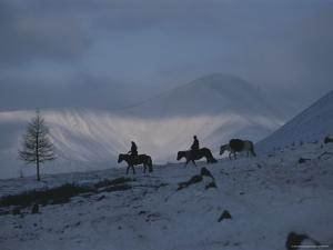 Mongolian Horseback Riders Atop Utreg Pass in the Hordil Mountains by Gordon Wiltsie