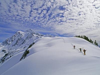 Off-Piste Skiers Hike Below Mount Shuksan, Near Mount Baker Ski Area by Gordon Wiltsie