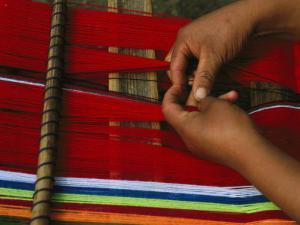 Peruvian Woman Weaving with Colorful Yarn by Gordon Wiltsie