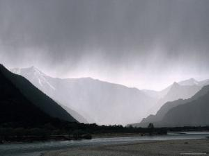 Rain Falls Over a Remote Valley East of Lhasa by Gordon Wiltsie