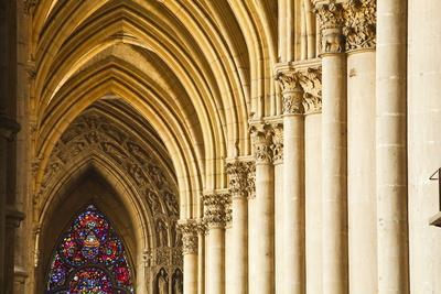 https://imgc.allpostersimages.com/img/posters/gothic-arches-and-capitals-inside-the-notre-dame-de-reims-cathedral_u-L-PNFYUP0.jpg?artPerspective=n