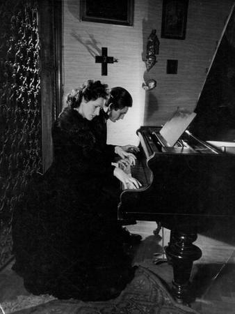 https://imgc.allpostersimages.com/img/posters/gothic-piano-duet_u-L-Q1072NL0.jpg?p=0