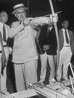 Governor Lewis O. Barrow Mixing Archery and Politics While Campaigning for Reelection