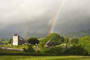A Rainbow over St. David's Church in the Tiny Welsh Hamlet of Llanddewir Cwm, Powys, Wales by Graham Lawrence