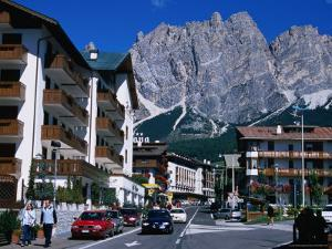 Apartment Buildings with Cliffs of Cristallo Group Behind, Cortina, Veneto, Italy by Grant Dixon