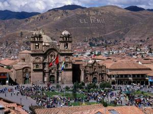 Crowds Mingle on Plaza De Armas in Front of Church of La Compania De Jesus, Cuzco, Peru by Grant Dixon