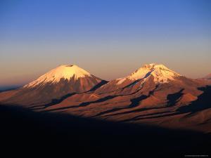 Volcanic Peaks of Mt. Parincota and Mt. Pomerata on the Chile/Bolivia Border, Oruro, Bolivia by Grant Dixon