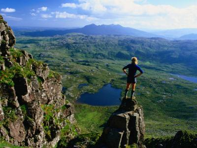 Walker Looking Towards Suilven from Stac Pollaigh, Scotland