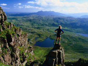 Walker Looking Towards Suilven from Stac Pollaigh, Scotland by Grant Dixon