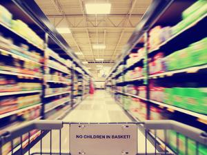 A Blurred Shot of an Isle in a Supermarket or Grocery Store Shop Done with a Retro Vintage Instagra by graphicphoto