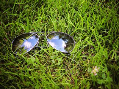 A Pair of Aviators on the Grass Toned with a Retro Vintage Instagram Filter by graphicphoto