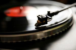 Close up View of Old Fashioned Turntable Playing a Track from Black Vinyl. by graphicphoto