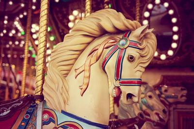 Merry-Go-Round Wooden Horses Toned with a Retro Vintage Instagram Filter Effect