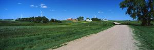 Gravel and dirt road through farm, North Dakota, USA