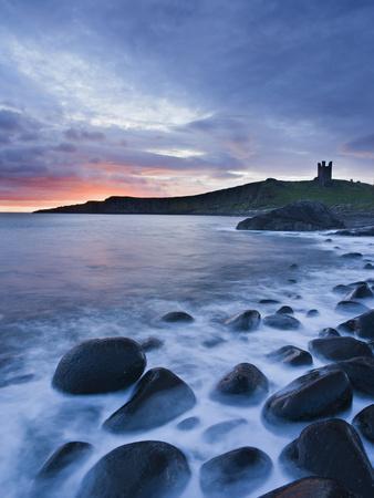 https://imgc.allpostersimages.com/img/posters/great-britain-england-northumberland-dunstanburgh-castle-sea-stones-dusk_u-L-Q11YHQ70.jpg?p=0
