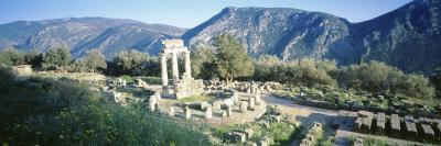 https://imgc.allpostersimages.com/img/posters/greece-delphi-the-tholos-ruins-of-the-ancient-monument_u-L-P18LNP0.jpg?p=0