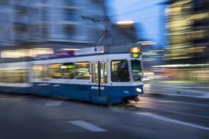 A Blurred Motion View of a Tram at Night in Zurich, Switzerland by Greg Dale
