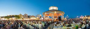 A Crowd of People Enjoy an Outdoor Friday Night Concert at Rehoboth Beach by Greg Dale