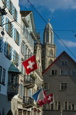 Architecture and Flags in Downtown Zurich by Greg Dale