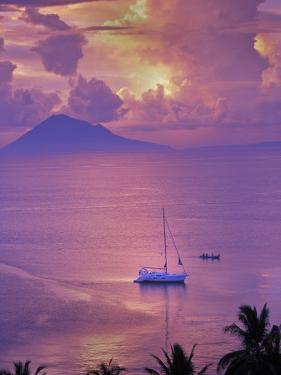 Sailboat Anchored in the Pacific Ocean at Sunset Off the Manado Coast by Greg Dale