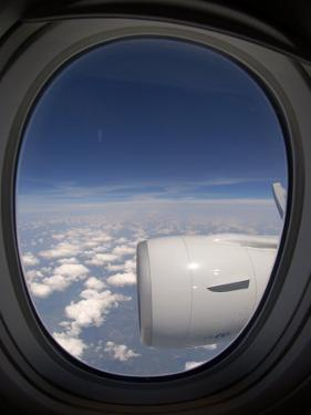 View Out of an Airplane Window During Flight by Greg Dale