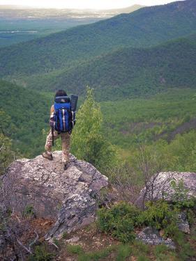 Woman Backpacker Looking at the Valley in Shenandoah National Park by Greg Dale