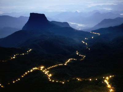 A Long Line of Lights Illuminates the Path to Adam's Peak During the Poya Festival, Sri Lanka by Greg Elms
