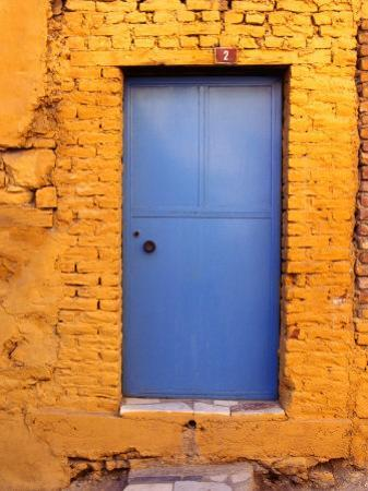 Blue Door on Yellow Brick House., Milas, Mugla, Turkey by Greg Elms