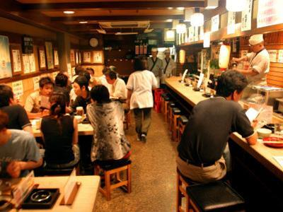 Customers Dining at Oden Restaurant, Shinjuku, Tokyo, Japan by Greg Elms