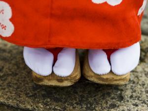 Feet and Dress of a Young Maiko (Apprentice Geisha) Girl in Shirakawa-Miname-Dori Street by Greg Elms