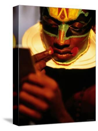Kathakali Dancer Applying Make-Up, Kochi, Kerala, India by Greg Elms