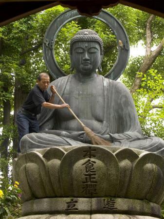 Man Cleaning a Buddha Statue, Shinnyo-Do Temple, Kyoto, Kinki, Japan by Greg Elms